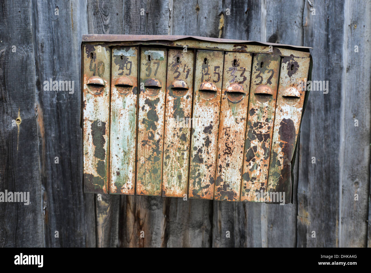 Old Rusty Russian Mailbox. Metal Mailbox rusted over from Soviet times. - Stock Image