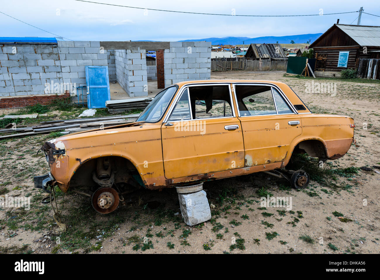 Old Broken Down Russian Car in the town of Khuzir, Lake Baikal, Russia. - Stock Image