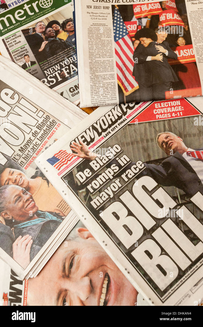 Front pages of New York newspapers report on Bill De Blasio's victory in the previous day's mayoral election - Stock Image