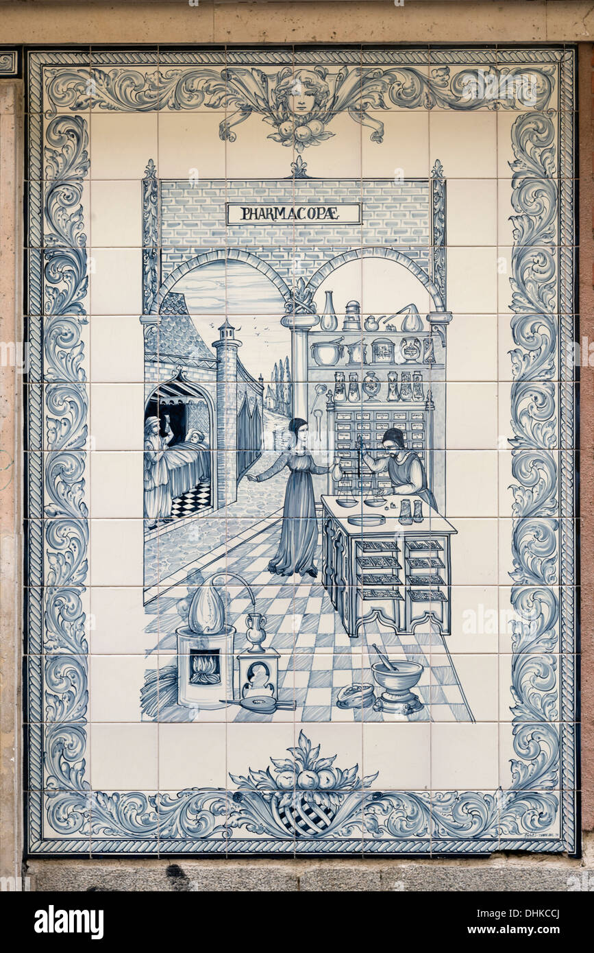 Decorative tiles outside pharmacy in Huertas district, Madrid, Spain - Stock Image