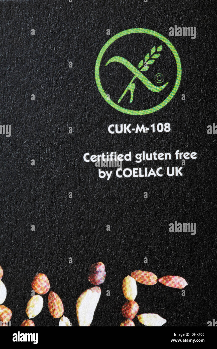 Certified gluten free by Coeliac UK on packet of Eat Natural peanuts almonds and hazelnuts - Stock Image