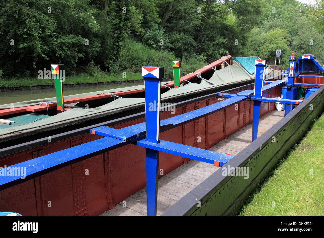 Freight carrying narrowboat, empty of cargo, moored on the Grand Union Canal at Stoke Bruerne - Stock Image