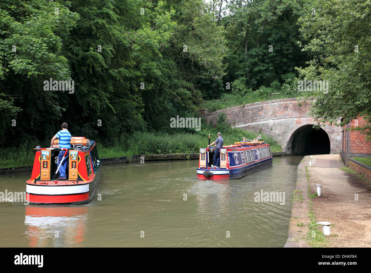 Two narrowboats approaching the southern portal of Blisworth Tunnel on the Grand Union Canal at Stoke Bruerne - Stock Image