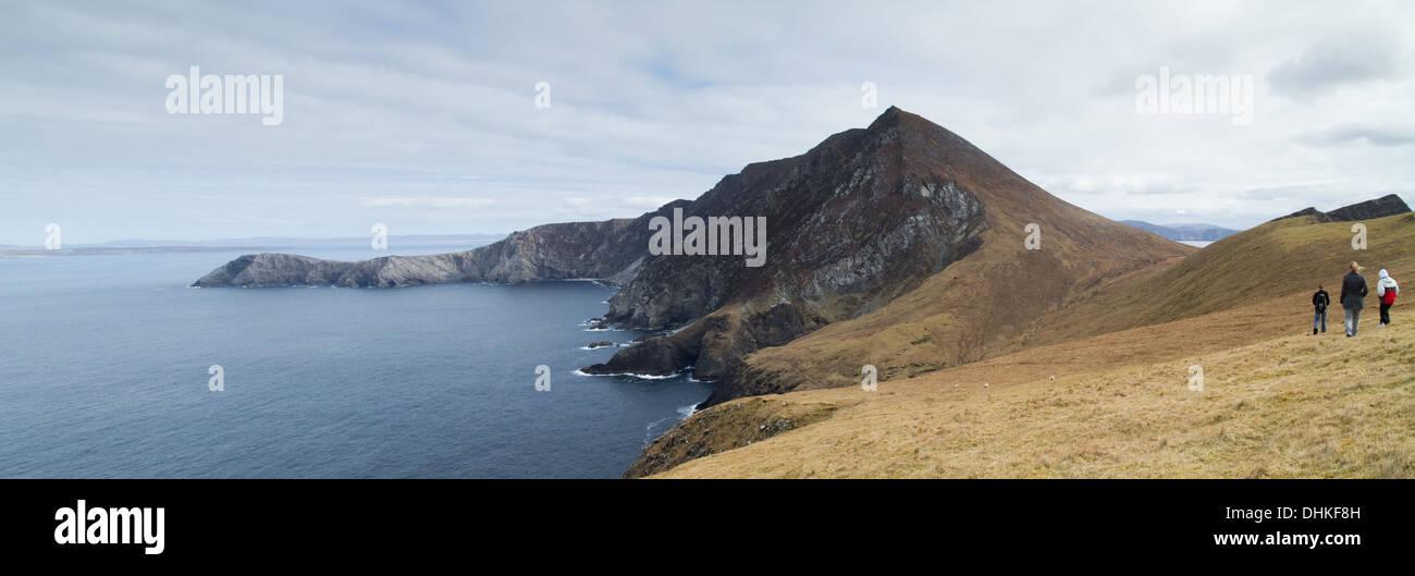 Three walkers on Achill island County Mayo Ireland - Stock Image