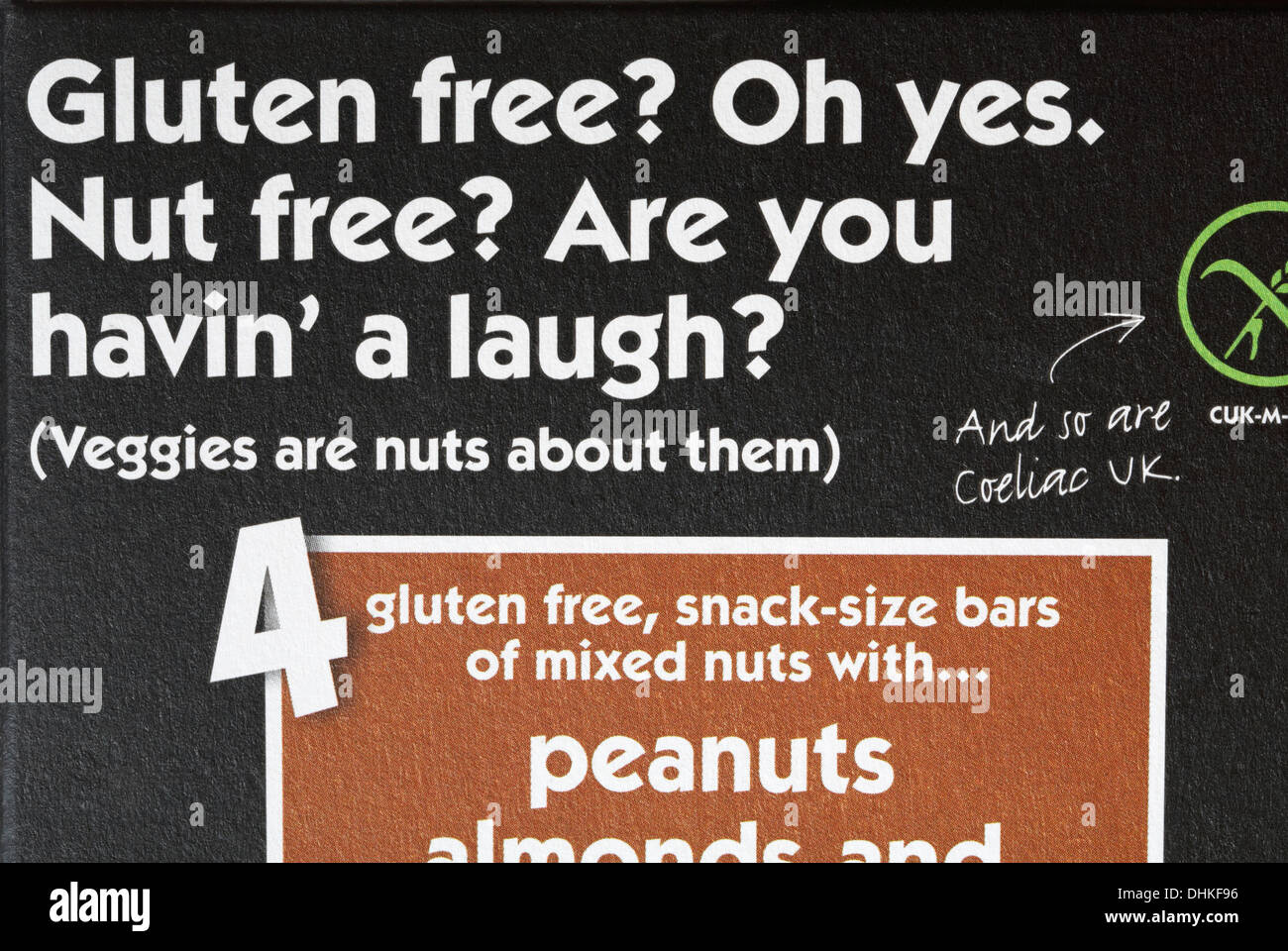 Gluten free? Oh Yes Nut Free? Are you havin' a laugh? information on packet of Eat Natural peanuts almonds and hazelnuts - veggies are nuts about them - Stock Image