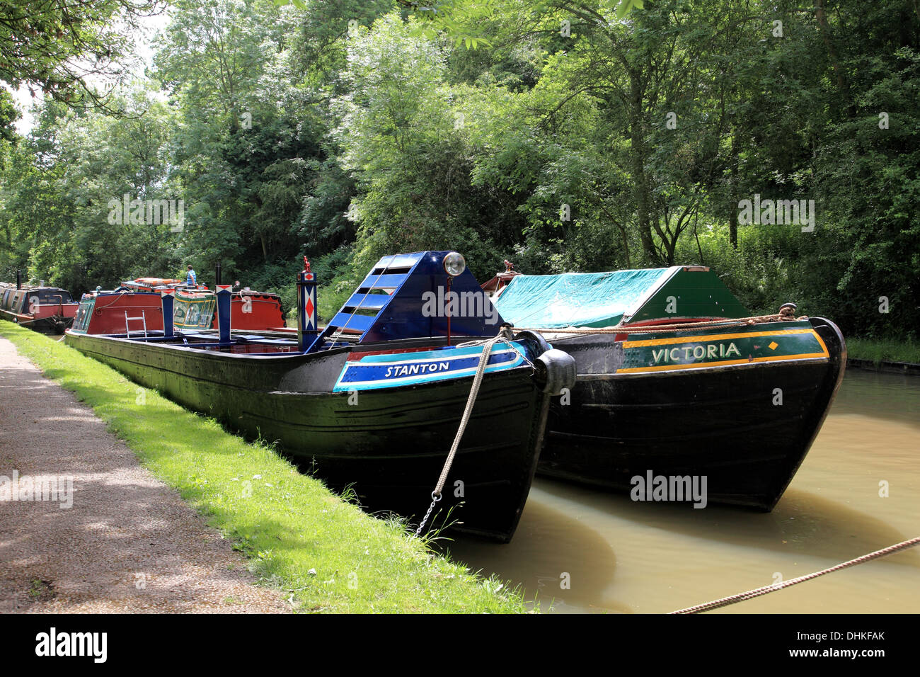 Two historic freight carrying narrowboats moored on the Grand Union Canal at Stoke Bruerne - Stock Image