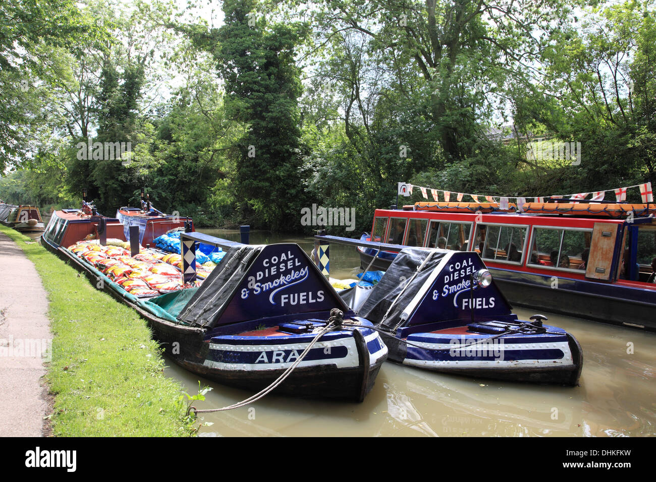 Two historic coal carrying narrowboats moored on the Grand Union Canal at Stoke Bruerne - Stock Image