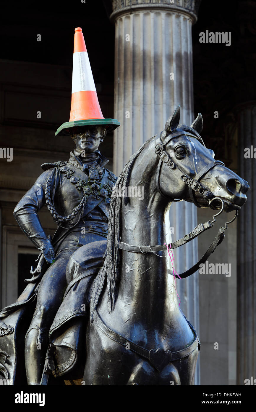 The Duke of Wellington Statue with a cone on it's head, Glasgow, Scotland, UK Credit:  Kenny Williamson / Alamy Stock Photo