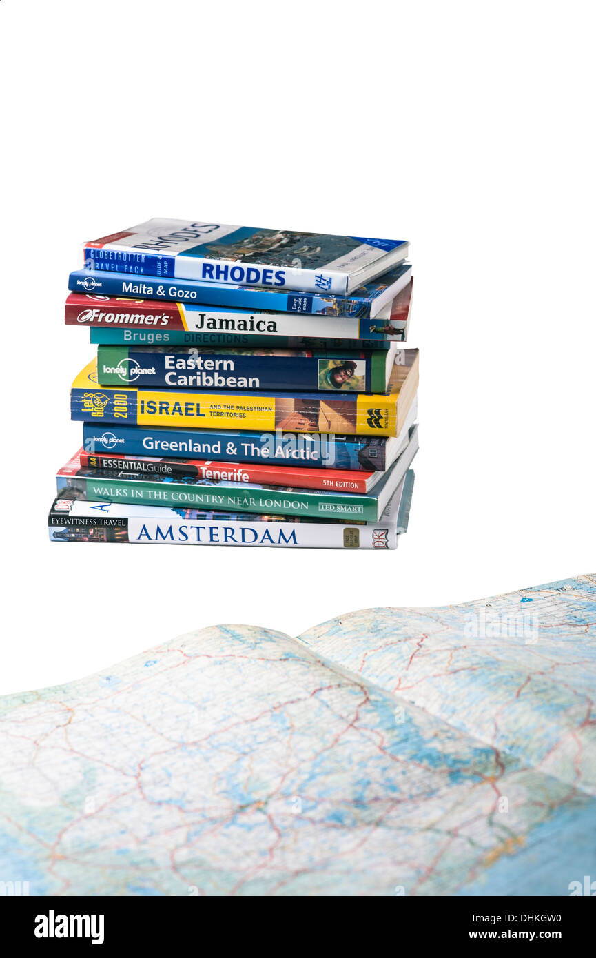 Travel guides with map.Holiday planning. - Stock Image