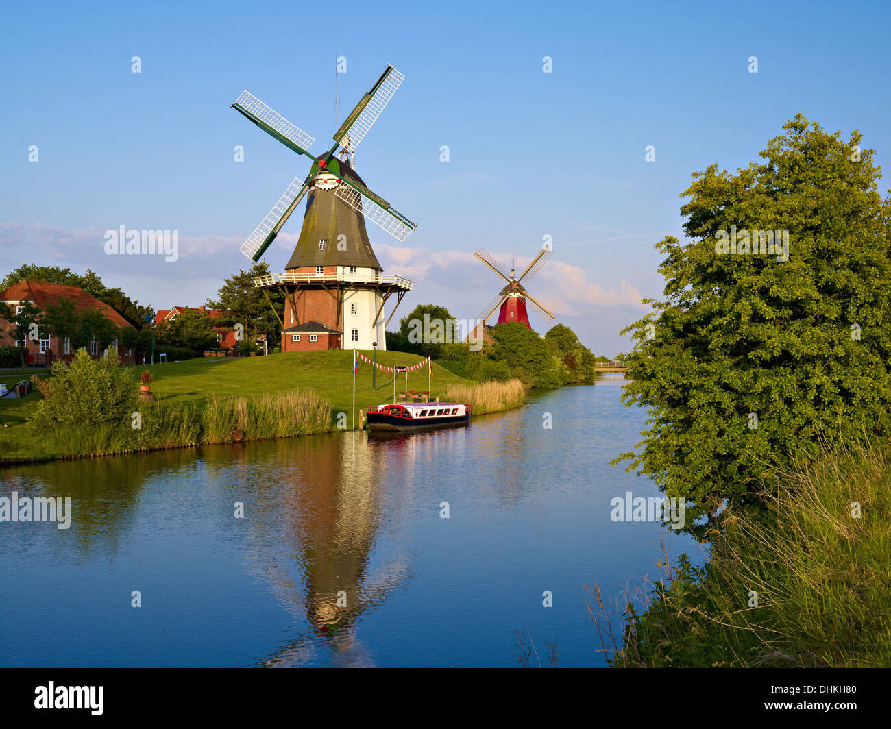 Windmills on the sewer in Greetsiel, East Frisia, Germany - Stock Image