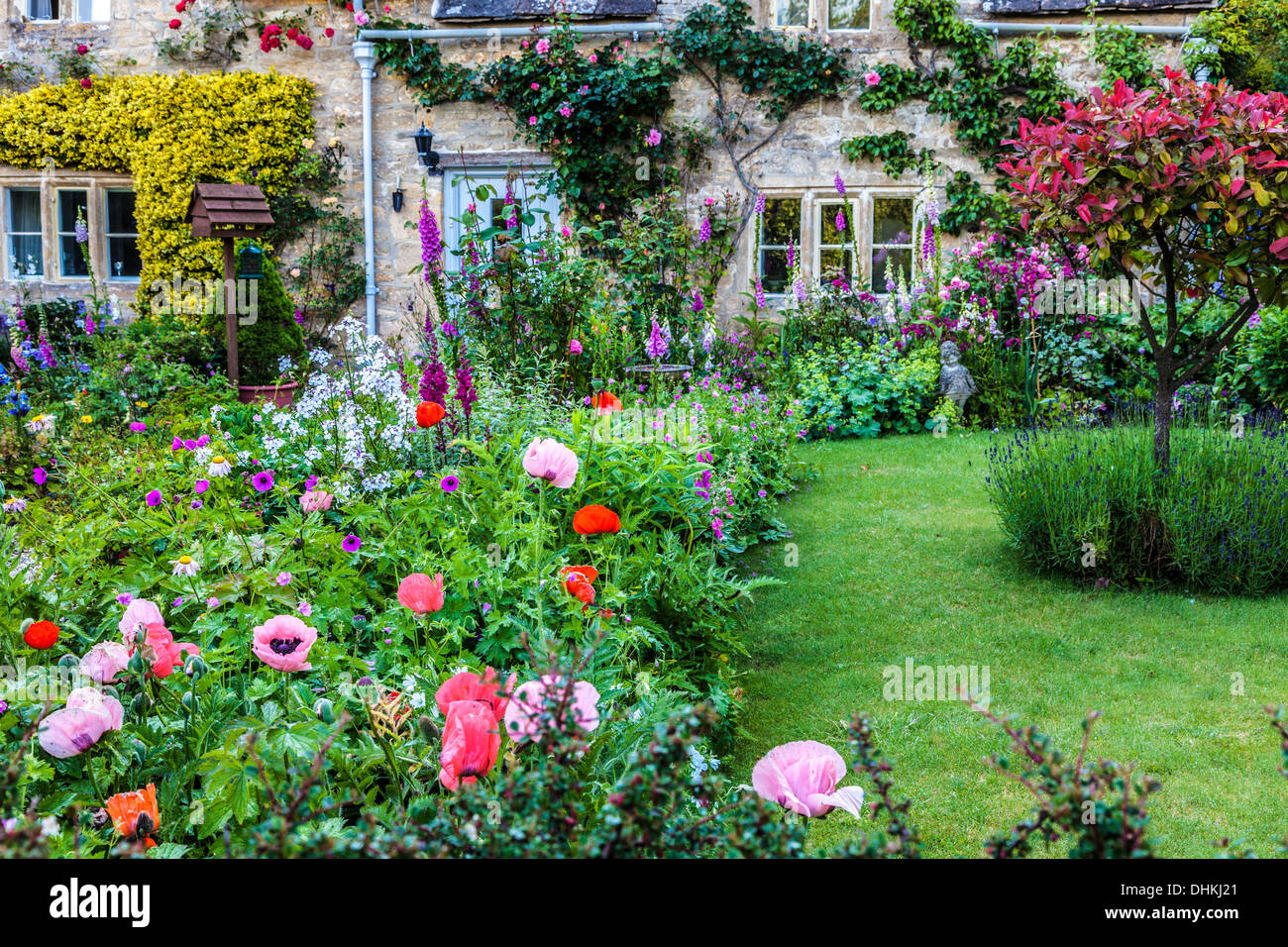 Stone house cottage garden stock photos stone house cottage garden a pretty english cottage garden in the cotswold village of bibury in summer stock workwithnaturefo