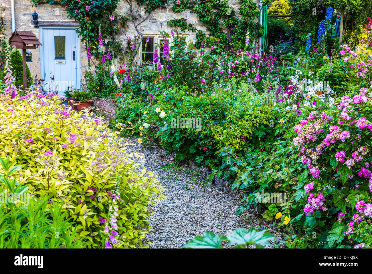 A Pretty English Cottage Garden In The Cotswold Village Of Bibury Summer