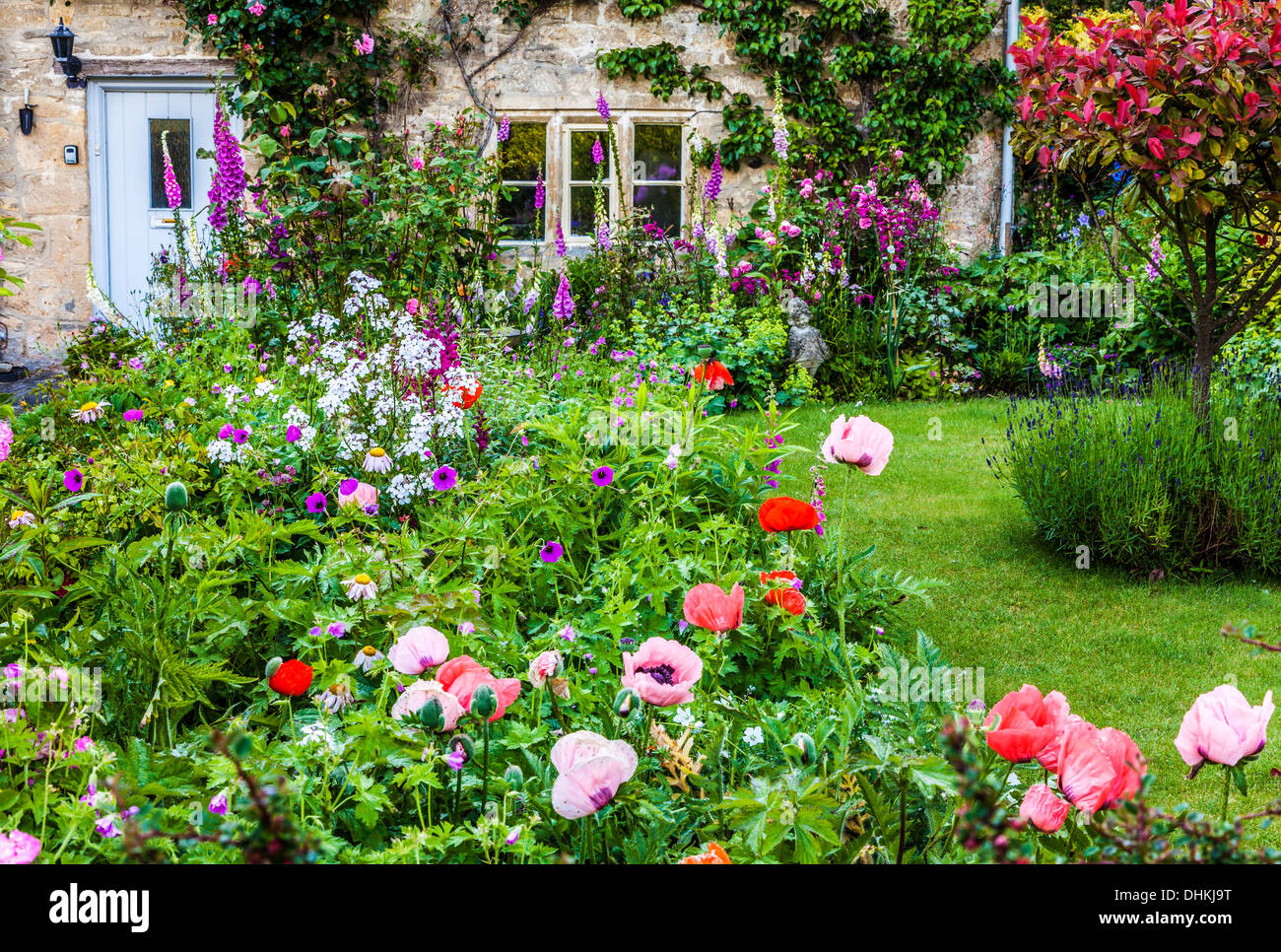 A Pretty English Cottage Garden In The Cotswold Village Of Bibury