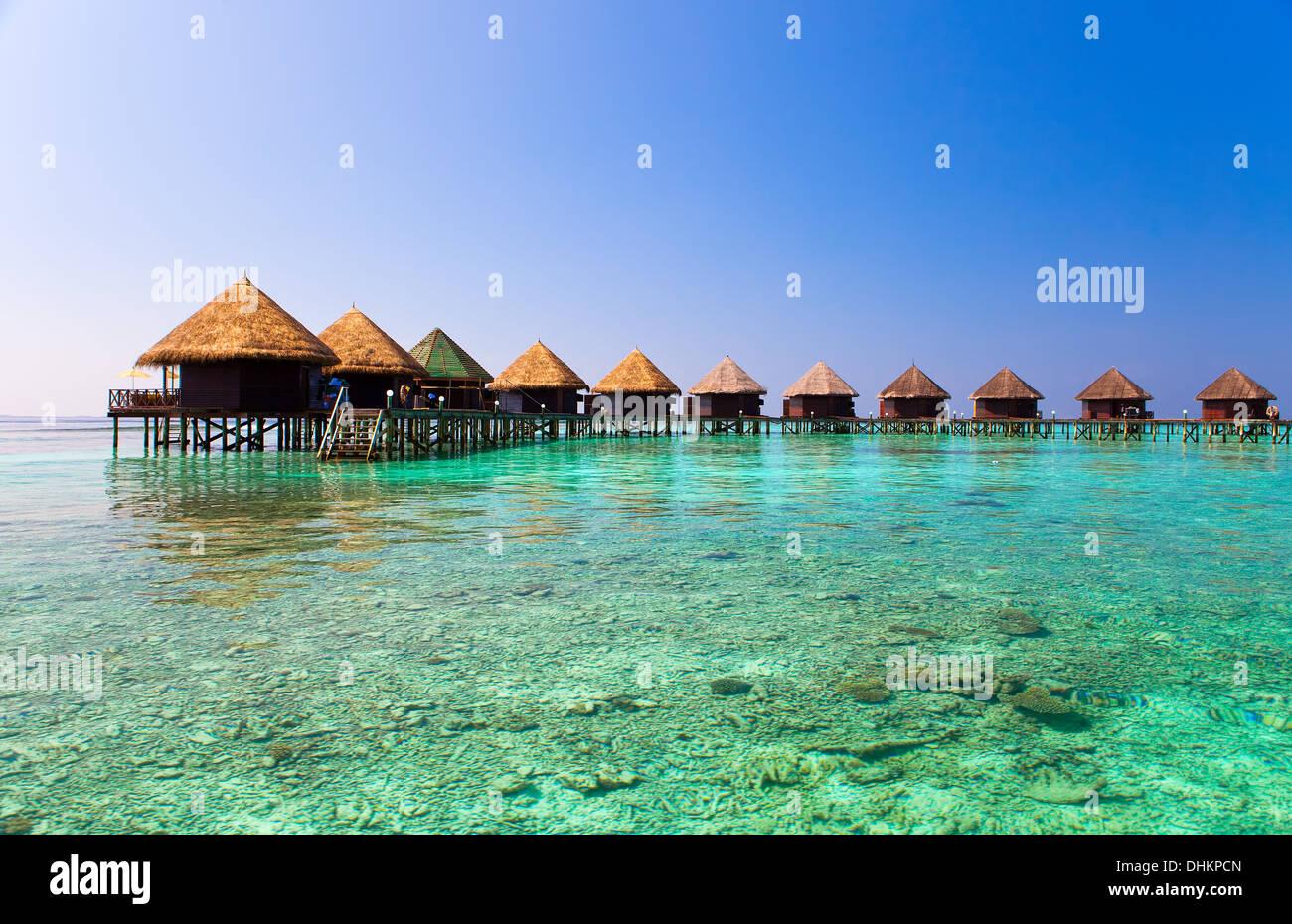 Maldives.   Villa on piles on water - Stock Image