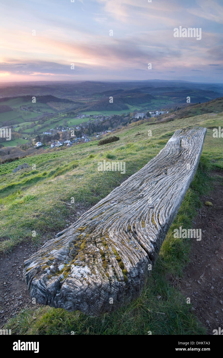 An old weathered wooden bench on the West side of the Worcesteshire Beacon, Malvern, at sunset. Stock Photo
