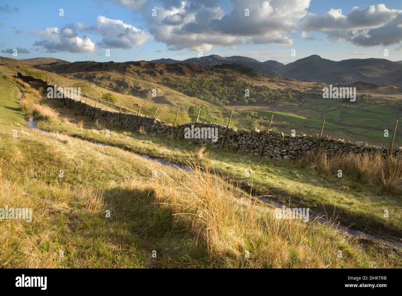 A horizontal image of a dry stone wall along one of the footpaths through Watendlath fells. Stock Photo