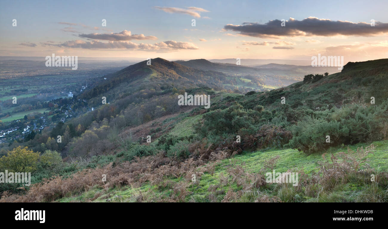 Panorama looking South across the Malvern Hills from Summer Hill at sunset. Stock Photo