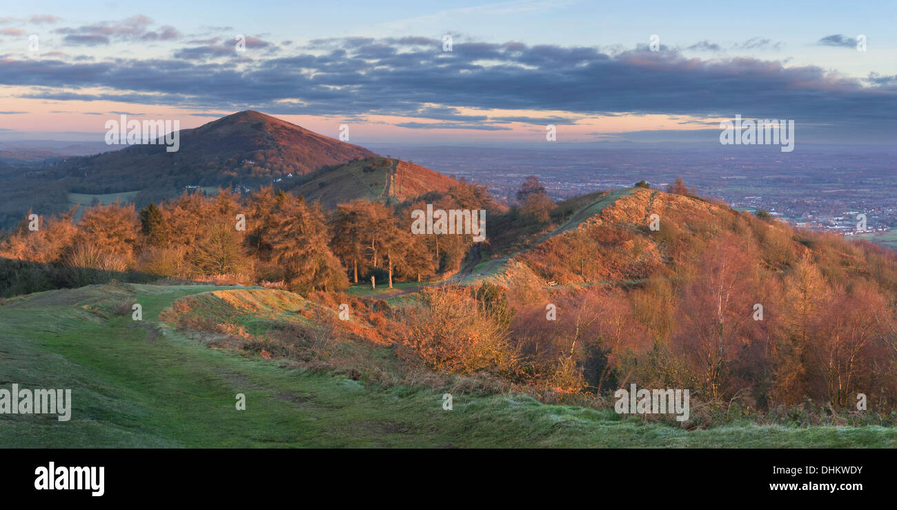 A panoramic photograph taken at sunrise from Pinnacle Hill, Malvern Hills, looking North towards Jubilee Hill, Perseverance Stock Photo