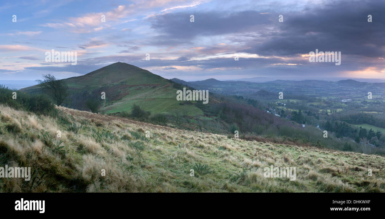A panoramic photograph of the Worcestershire Beacon on the Malvern hills at sunset from Table Hill. Stock Photo