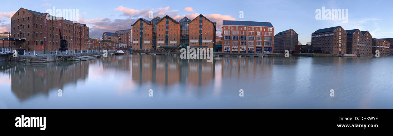 Sunset over the docks at Gloucester, with the old brick warehouse buildings being reflected in the water. Stock Photo