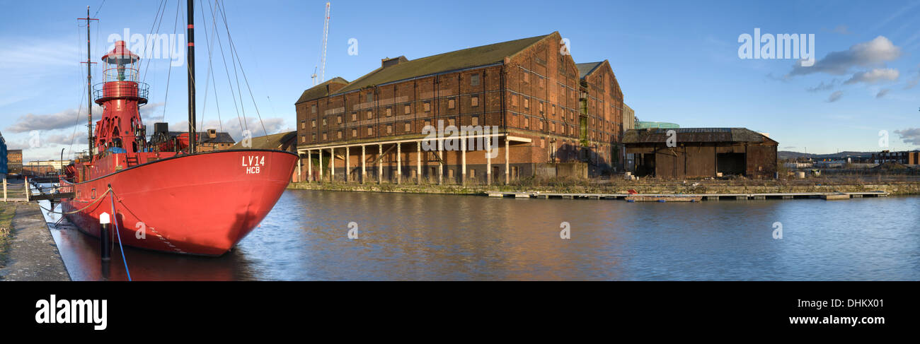 Buddhist Sula Lightship on the Gloucester Docks at sunset with the disused Warehouses in the background. Stock Photo