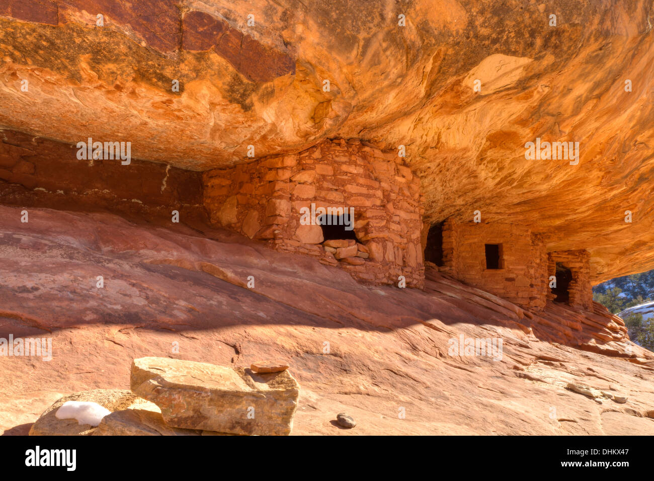 The 'House on Fire' Puebloan ruins under a cliff in Mule Canyon in the Cedar Mesa Plateau of Utah - Stock Image