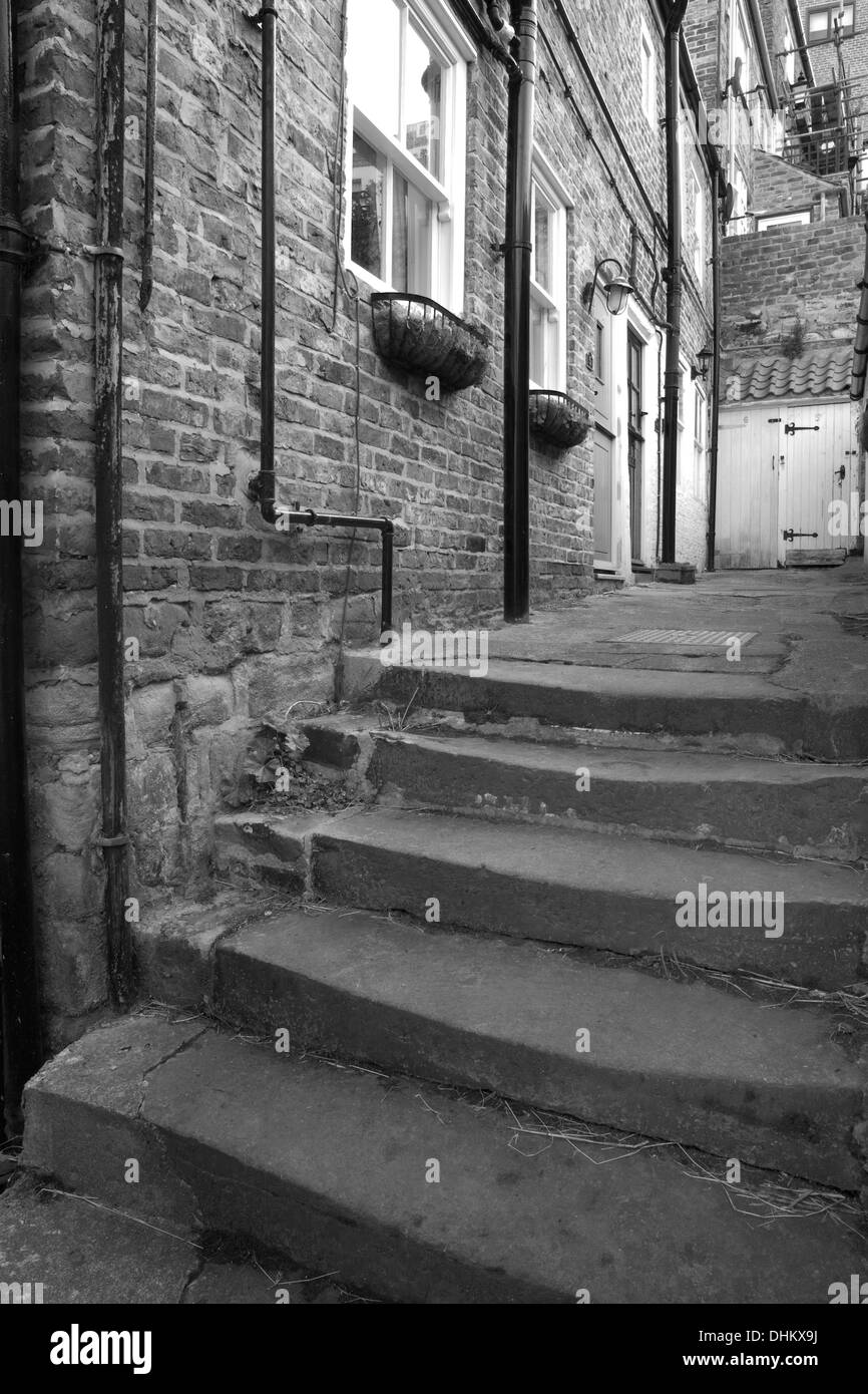 An old fisherman's Cottage, Benson's Yard, Church Street, Whitby in black and white. Stock Photo