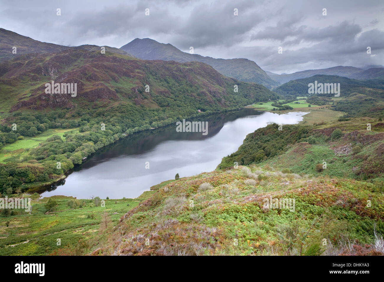 Llyn Dinas from above on an over cast day. Snowdon can be seen in the distance. Stock Photo