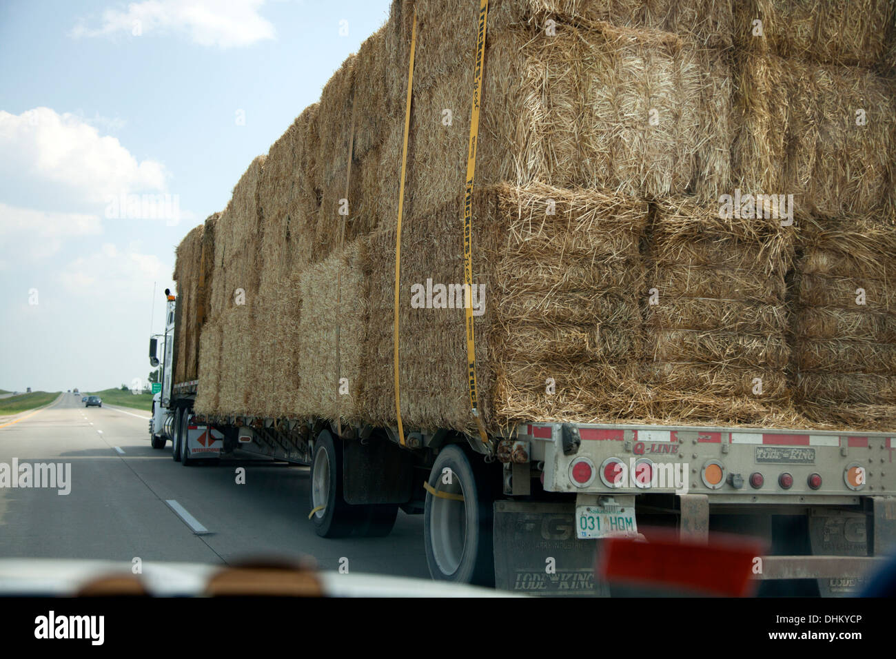 Bails of hay being transported by truck on Freeway 94. Alexandria Minnesota MN USA - Stock Image