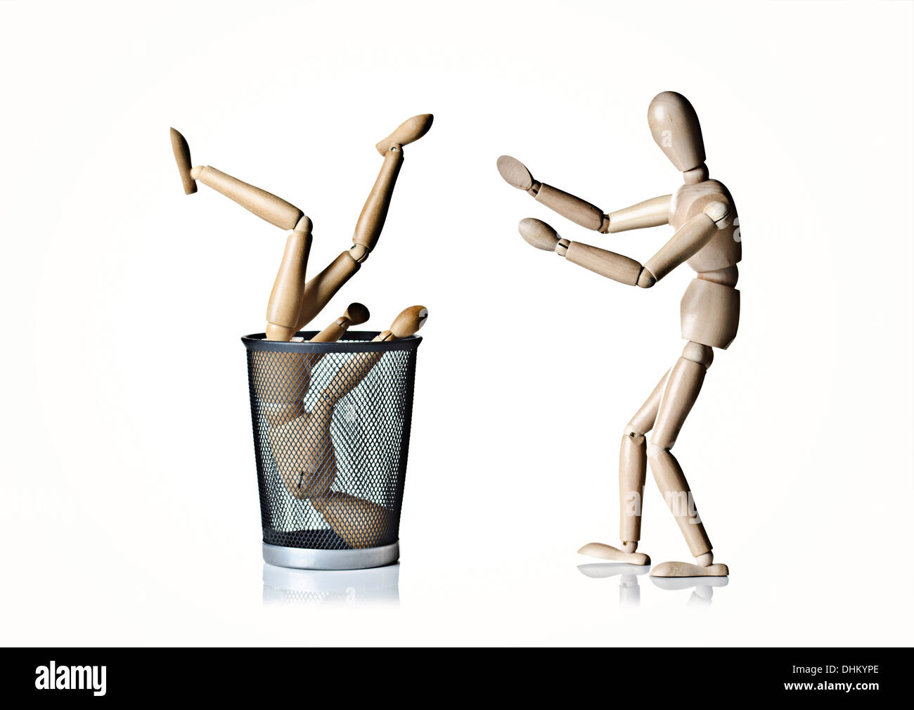 Two manikins, anatomical models, one in trash can, one helping the other - Stock Image