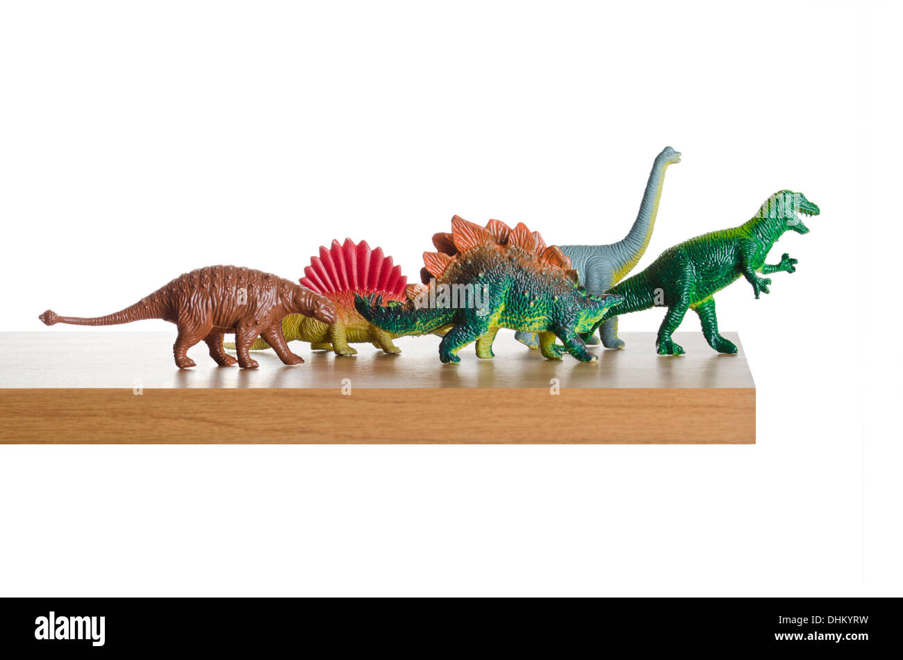 Dinosaurs walking off a cliff - Stock Image
