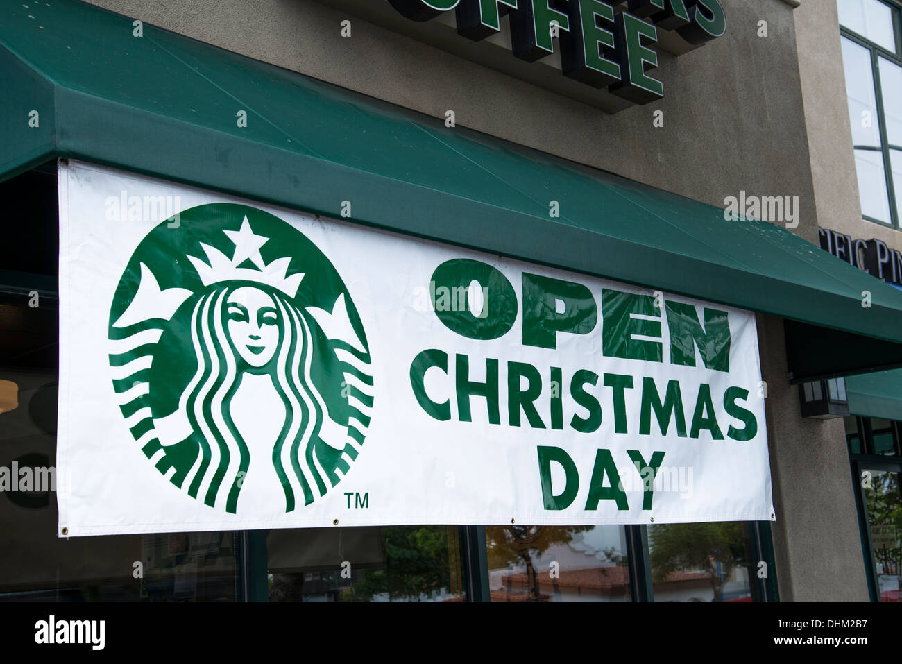 open christmas day sign in front of starbucks 784 west washington street san diego