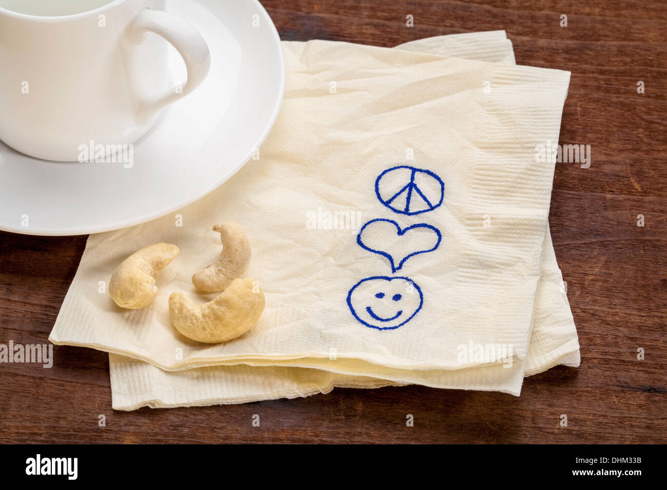 Peace Love And Happiness Symbols Sketched On A Napkin With A Cup Of