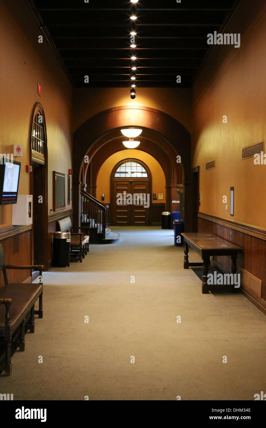 Hallway at Austin Hall, Romanesque Revival university building at Harvard Law School, Cambridge, MA, USA. - Stock Image