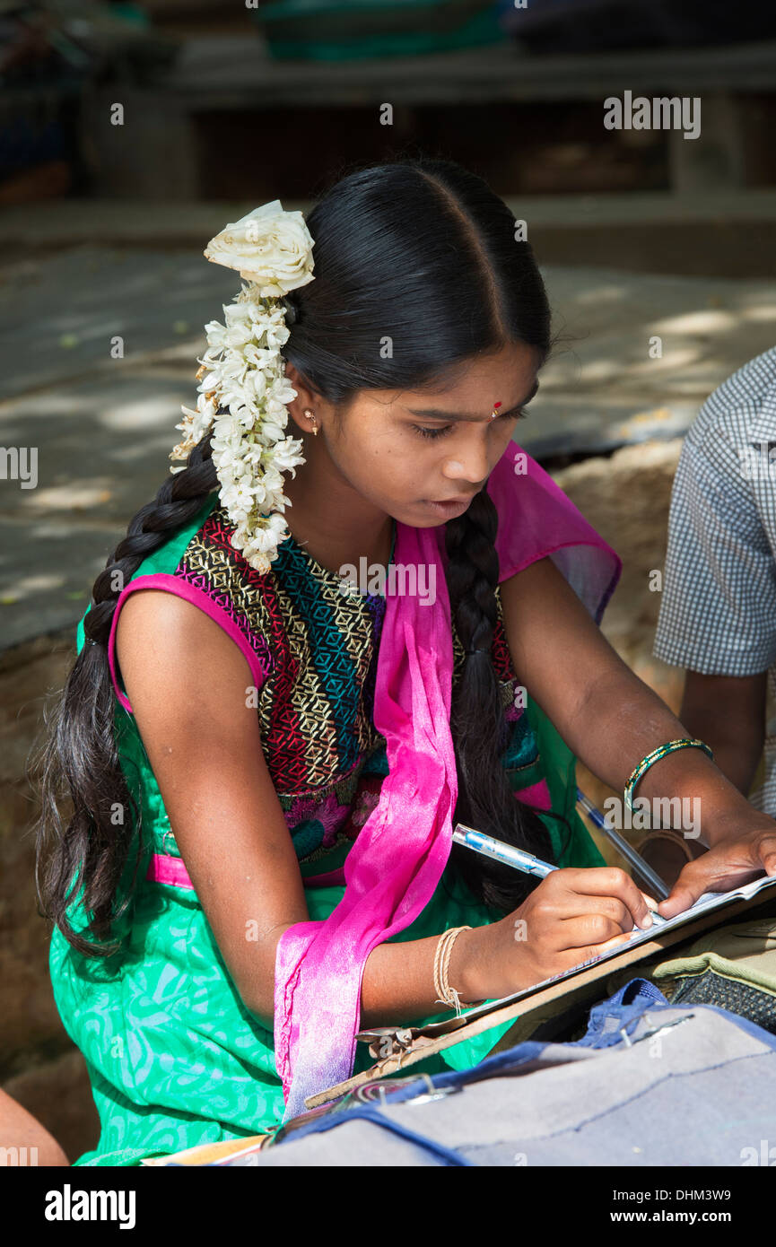 Rural Indian Village School Girl Writing In Books In An Outside Class Andhra Pradesh