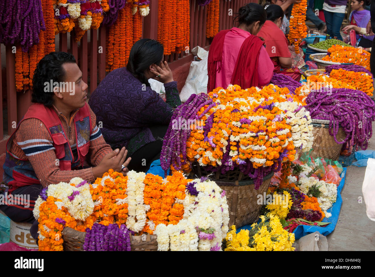 Selling garland in Kathmandu. - Stock Image