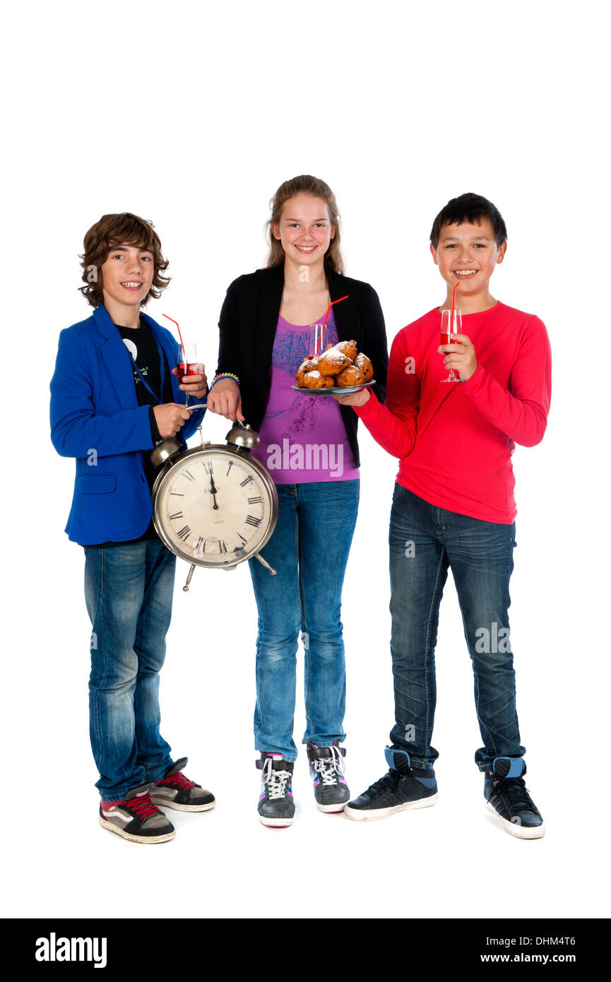 Cheers! on twelve o'clock on new year's eve, three teenagers celebrating New Year - Stock Image