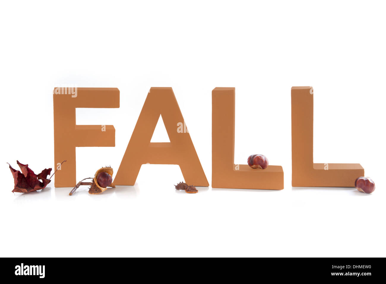 letters make the word fall with autumn leaves and chestnuts stock