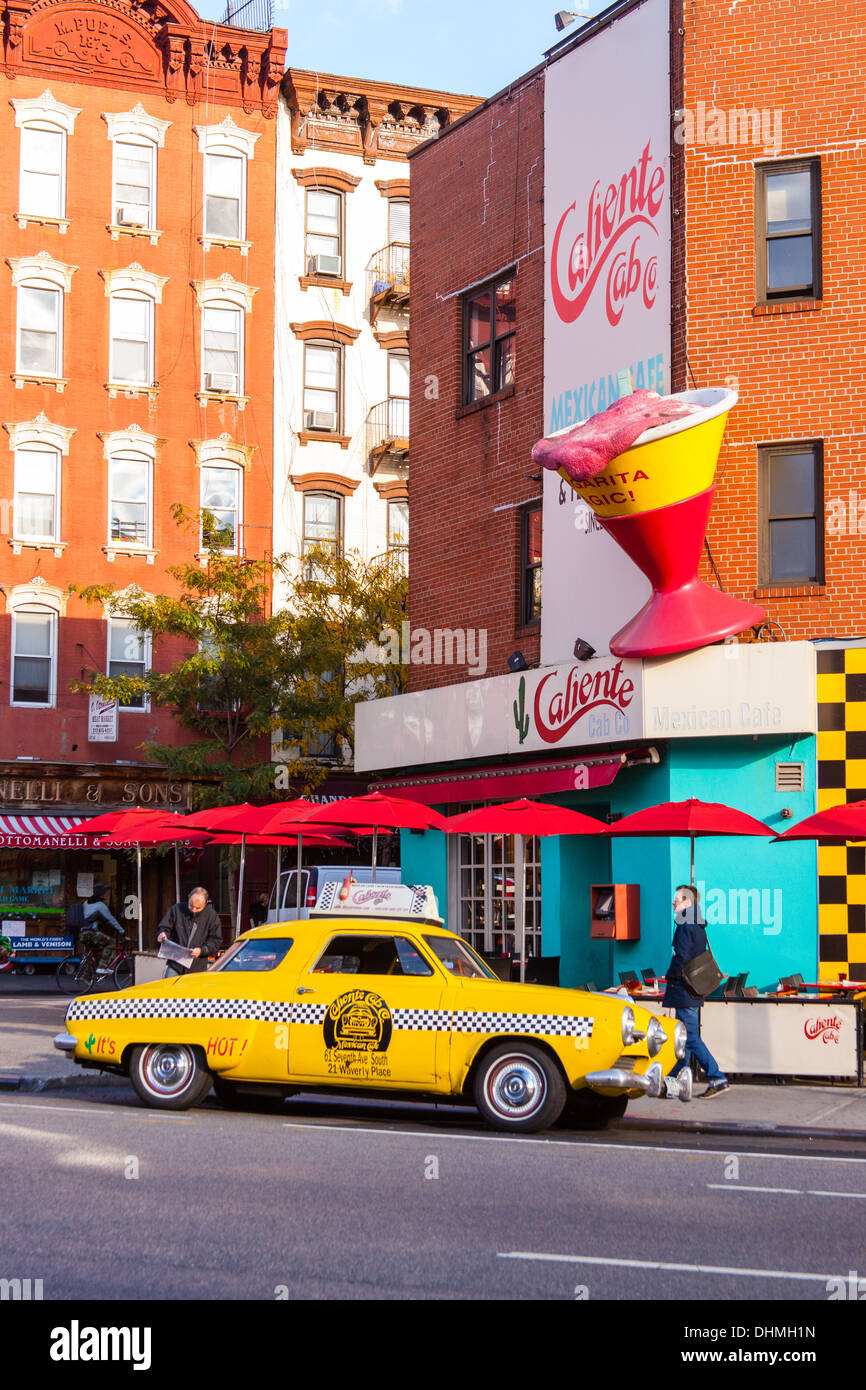 Vintage yellow taxi cab (1950's Studebaker) outside the