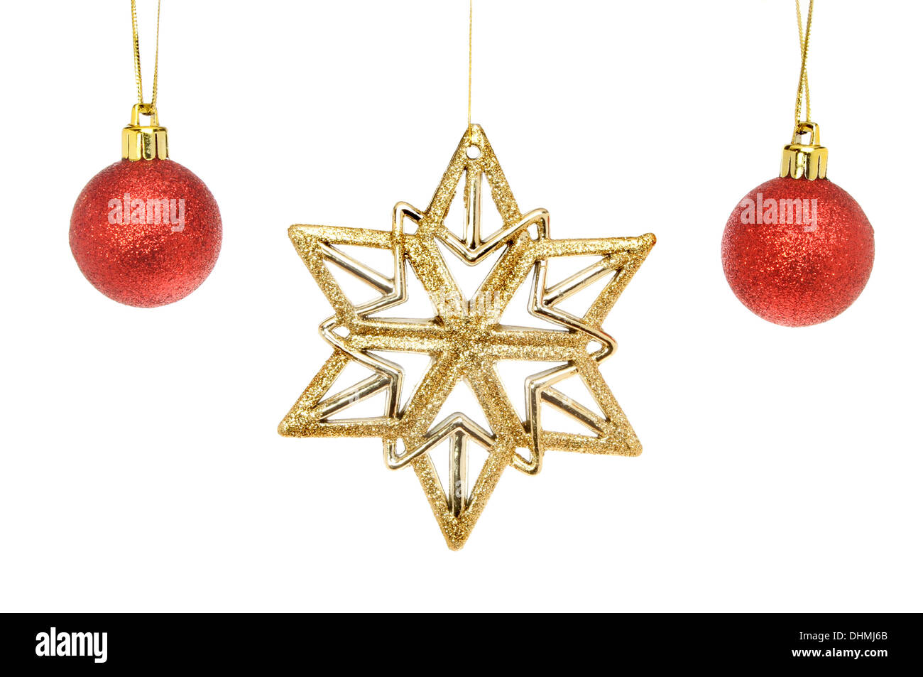 04d65496c83f Gold glitter Christmas star and red baubles isolated against white ...