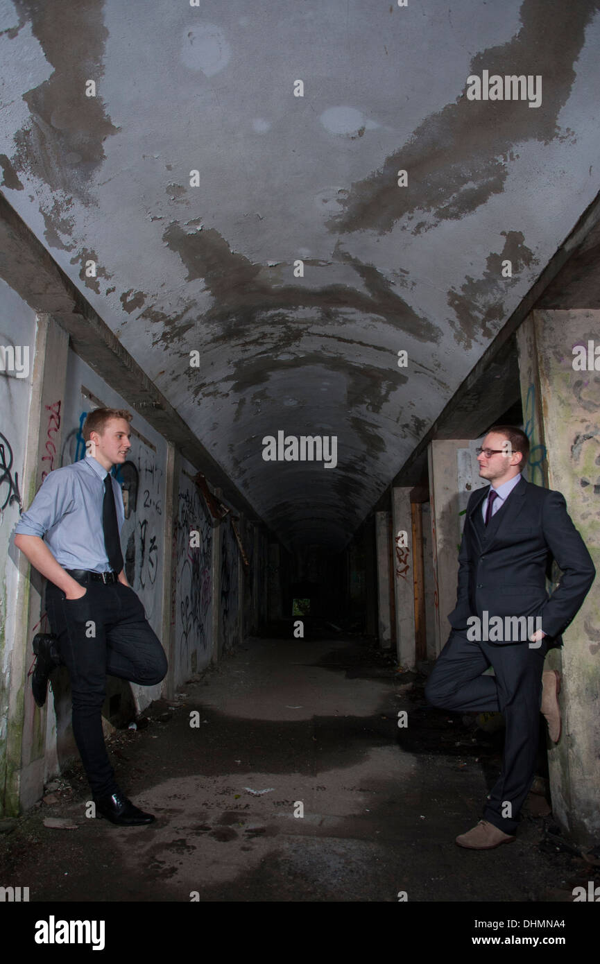 Models in a derelict building - Stock Image