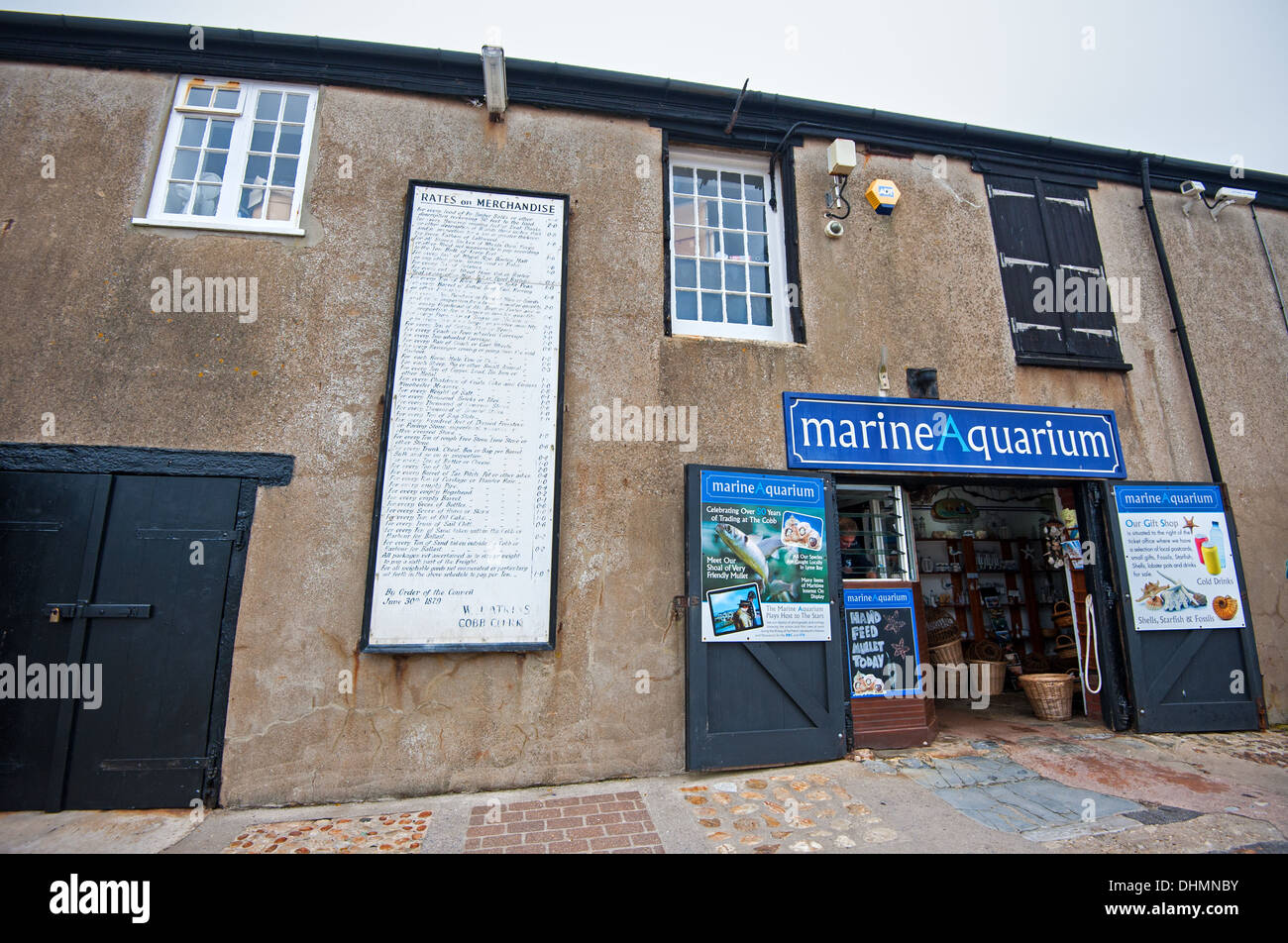 Rates on Merchandise sign on the wall of the Marine Aquarium in Lyme Regis - Stock Image