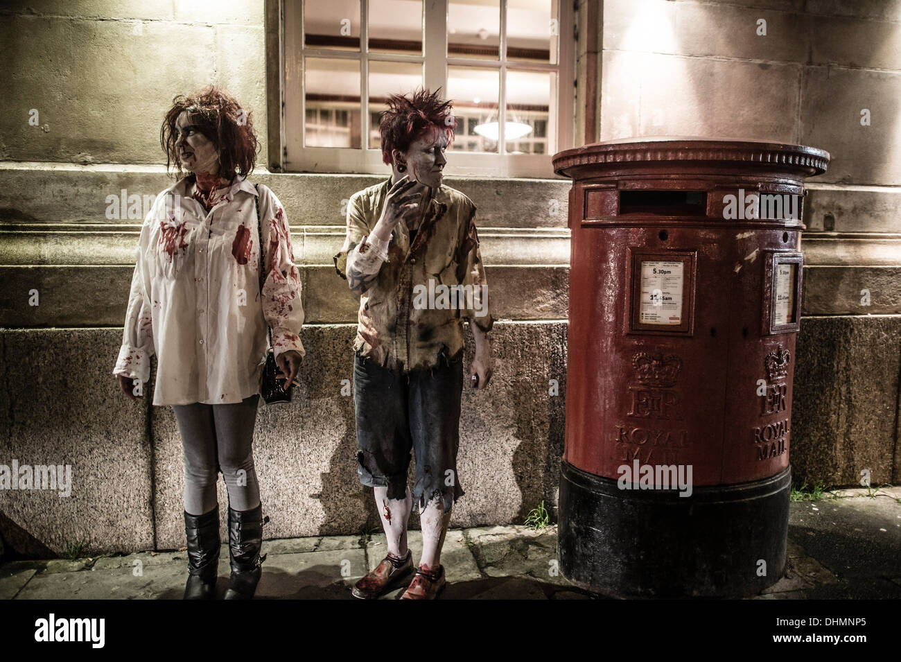 Two women dressed as zombies standing outside at night, UK - Stock Image