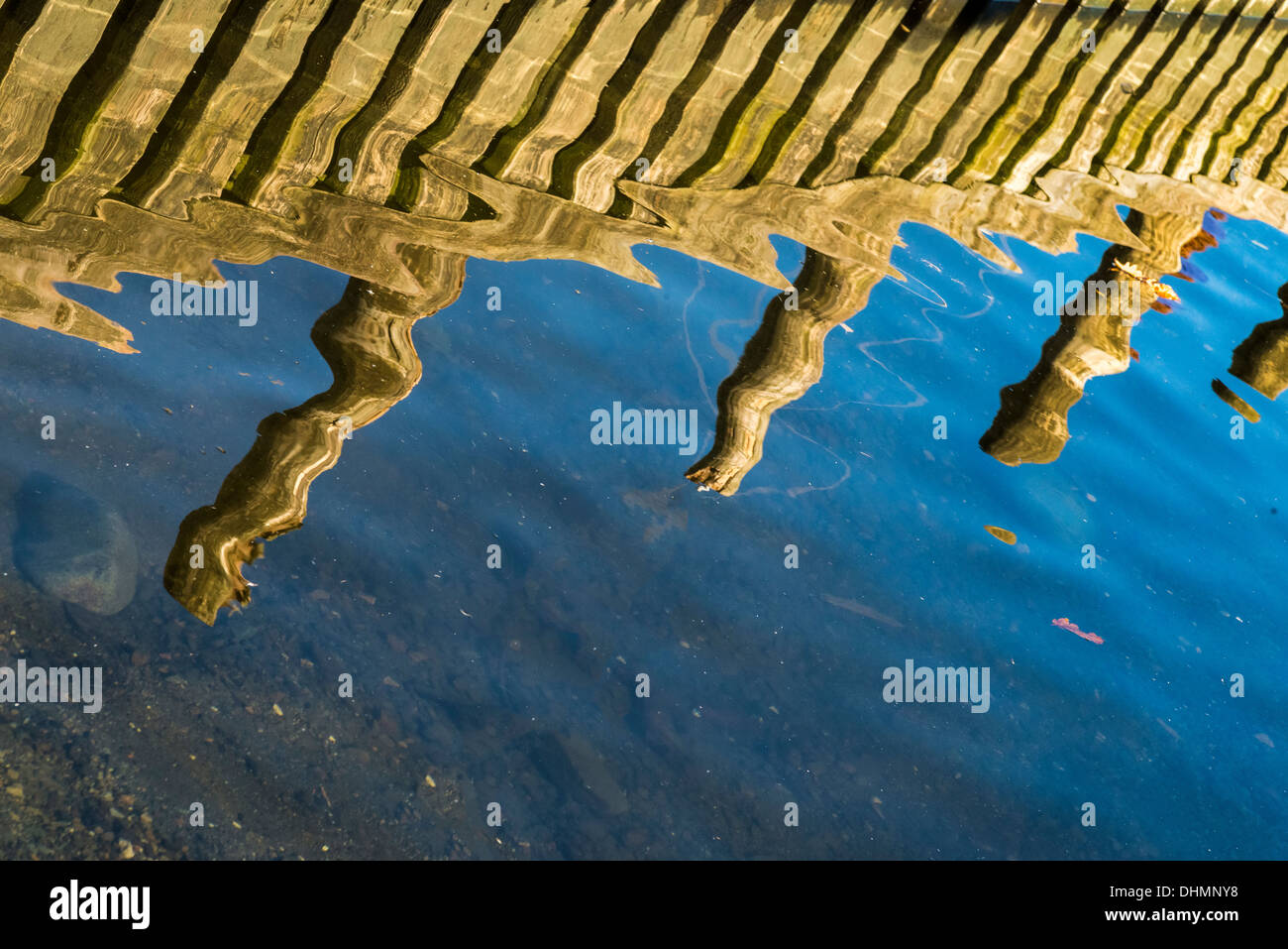 Ripples reflection lake pier wooden - Stock Image