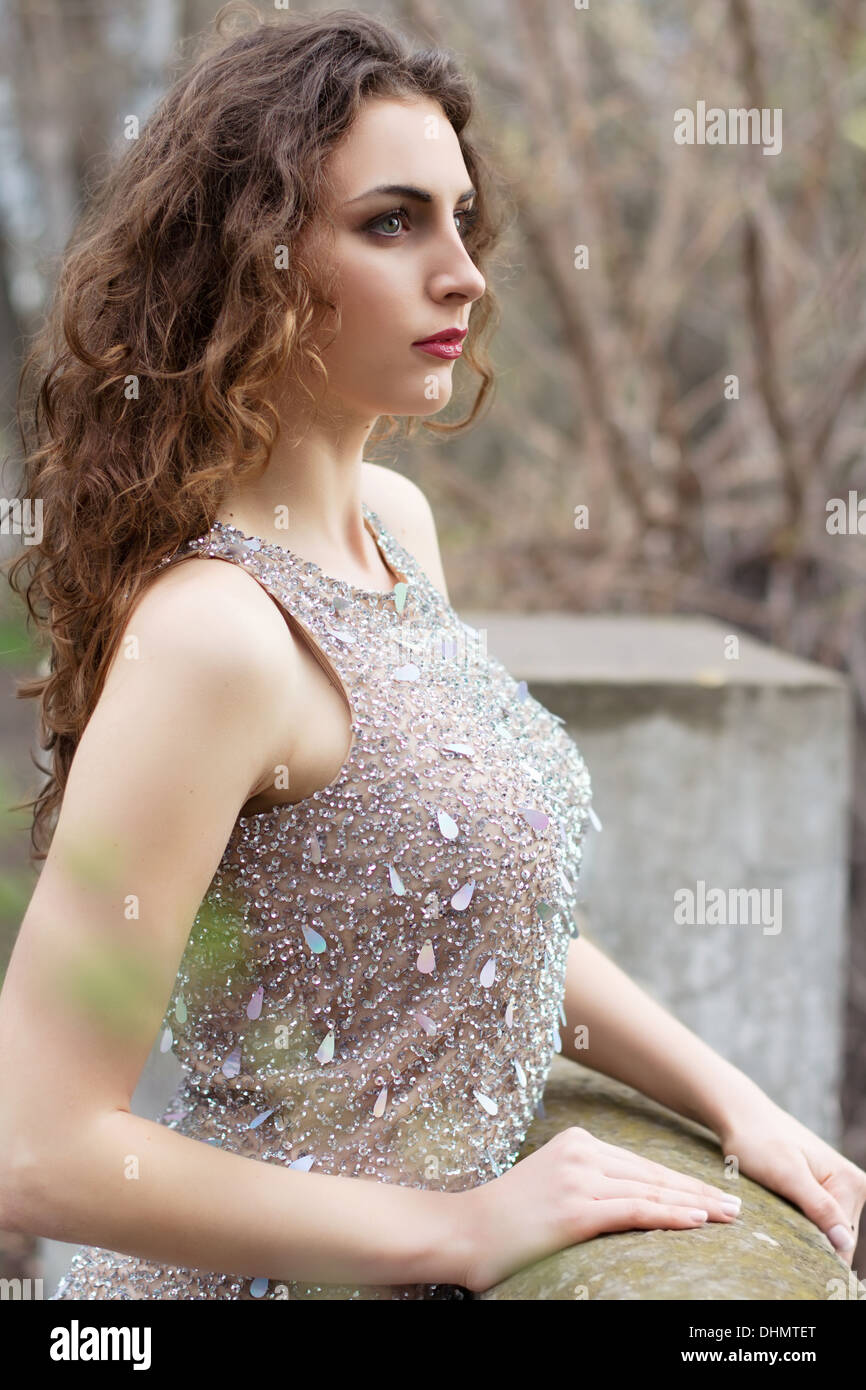 Alluring curly lady - Stock Image