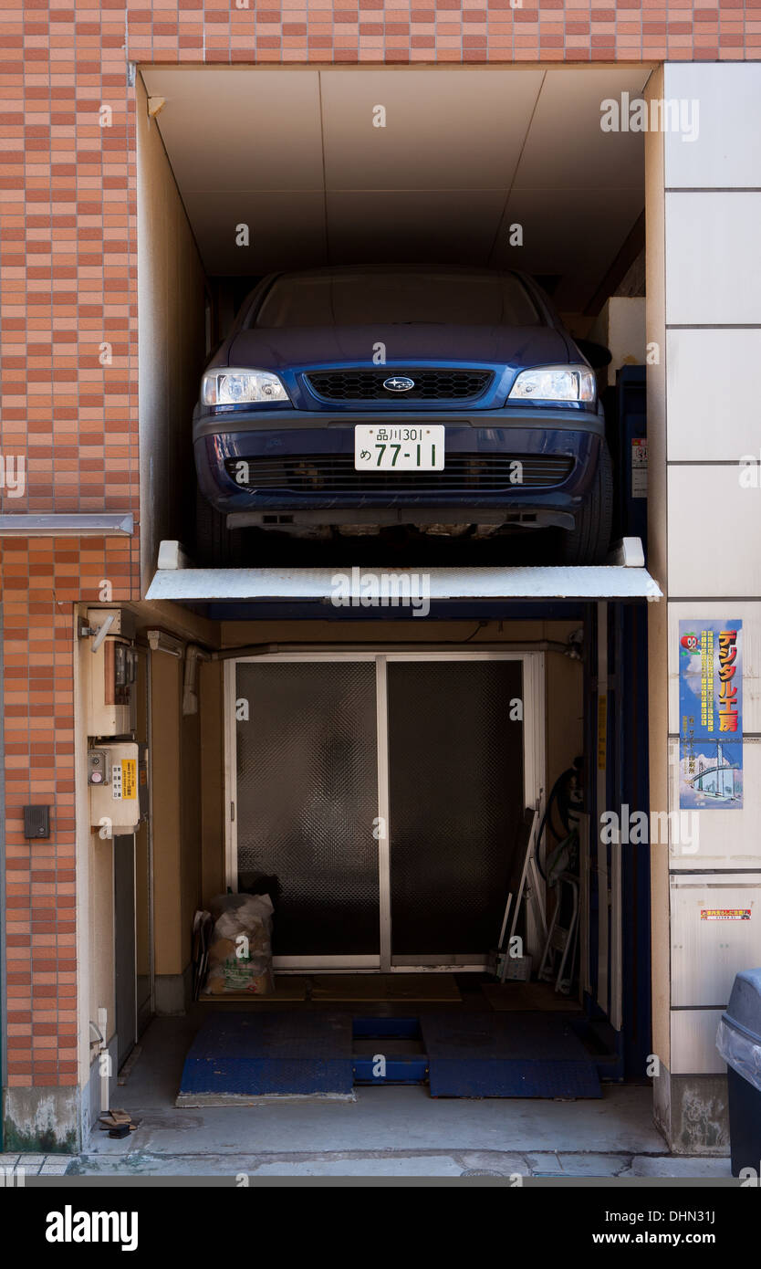 A car parked in a very small alcove in a house in Tokyo, Japan. Friday February 3rd 2012 - Stock Image