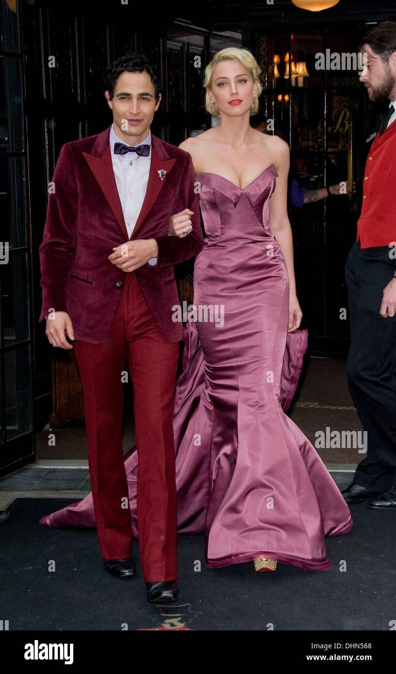 Zac Posen and Amber Heard leave their hotel New York City, USA - 07.05.12 Stock Photo