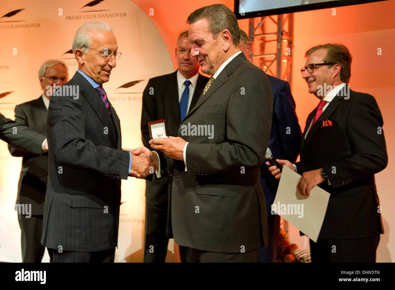 Hanover, Germany. 12th Nov, 2013. Former German Chancellor Gerhard Schroeder (SPD, 2nd R) awards brain surgeon Madjid Stock Photo