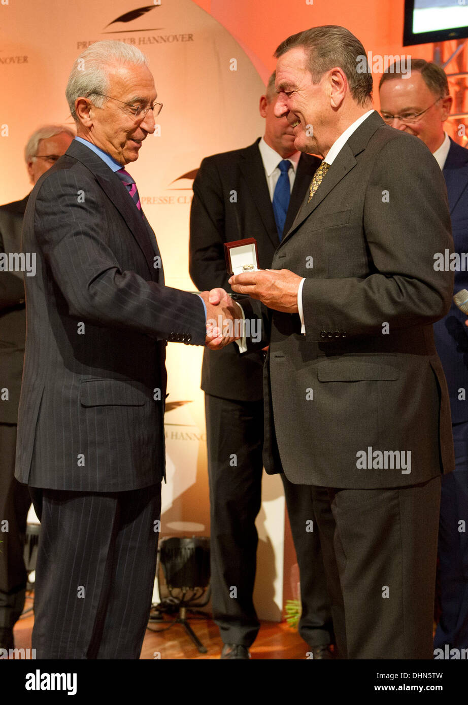 Hanover, Germany. 12th Nov, 2013. Former German Chancellor Gerhard Schroeder (SPD, R) awards brain surgeon Madjid Stock Photo