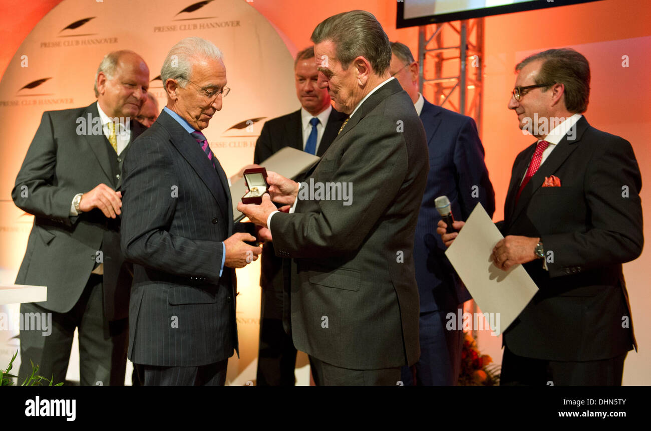 Hanover, Germany. 12th Nov, 2013. Former German Chancellor Gerhard Schroeder (SPD, 2nd R) awards brain surgeon Madjid Stock Photo